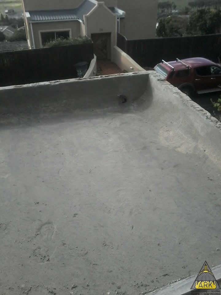 Waterproofing flat roof preparing screed fishhoek for Flat roof waterproofing paint